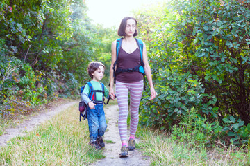 Boy and mom in the forest.