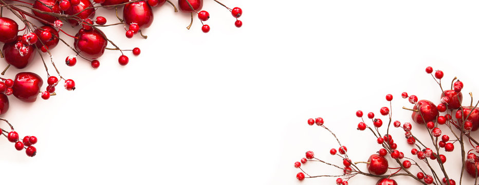 Christmas decoration with red apples and berries