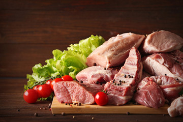 Pieces of different fresh meat on kitchen table