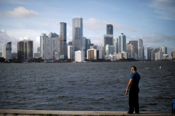 A local resident fishes at Biscayne bay before the arrival of Hurricane Irma to south Florida, in Miami, Florida