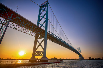 Zelfklevend Fotobehang Brug View of Ambassador Bridge connecting Windsor, Ontario to Detroit Michigan