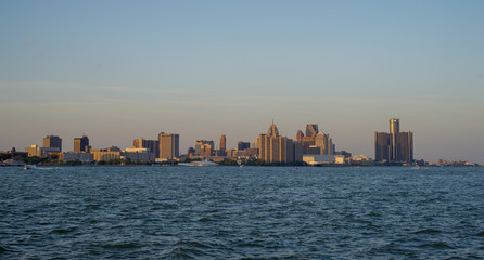 View of downtown Detroit skyline and river at sunset a