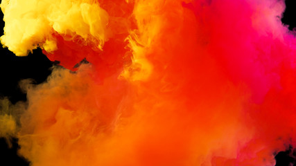 Colorful rainbow paint drops from above mixing in water. Ink swirling underwater. Cloud of ink isolated on black background. Colored abstract smoke explosion effect. Close up view