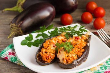 Baked stuffed eggplant with meat, tomatos and cheese.