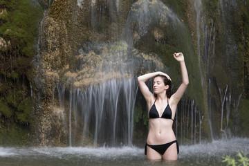 Teenage girl bathing in a lake.