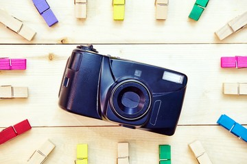 top view of Film camera on wooden table,Travel and vacation concept,Retro camera