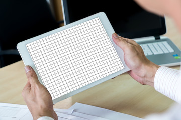 Mock up image of hands of man holding tablet