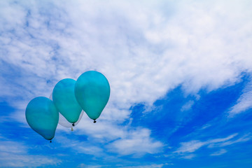 balloons green  flying on blue sky with copy space add text