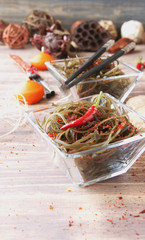 seaweed and chopsticks, on an open wooden table
