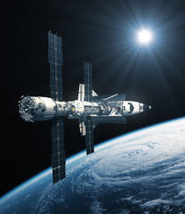 Fotobehang - Space Shuttle And International Space Station Orbiting Planet Earth