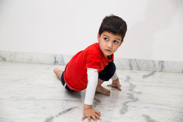 A four year old  Indian kid doing yoga for fitness