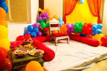 Balloon decoration - Stage for engagement ceremony decorated with colorful fabric and balloons