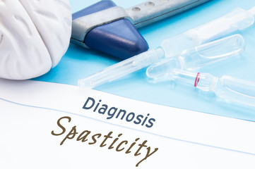 Neurological hammer, brain shape, syringe with needle and vials of medicines are next to inscription Diagnosis Spasticity. Diagnostics, treatment and prevention disease of nervous system Spasticity
