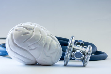 Brain near the stethoscope as symbol of health of organ, care, diagnostics, medical testing, treatment and prevention of diseases and pathology of brain as main neurological organ concept photo