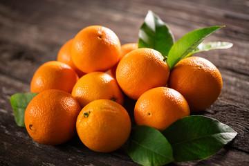 ripe raw orange fruits background many orange fruits.