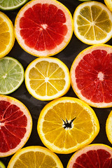 Citrus fruit background with a group of cultivated and harvested oranges lemons lime pomelo tangerines and grapefruit as a symbol of healthy eating.