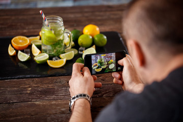 taking photo on smartphone of mojito drink.