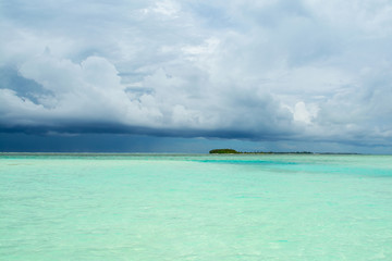Cloudy landscape of Indian ocean sandy beach before the storm