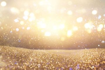 Gold and silver glitter vintage lights background. defocused