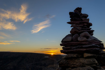 Mountain sunset with rocks