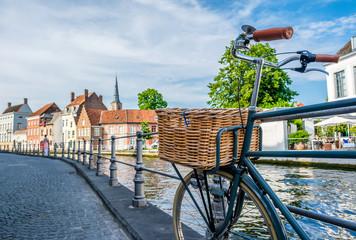Fotorolgordijn Brugge Bruges (Brugge) cityscape with bike