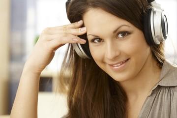 Closeup portrait of happy woman with headphones