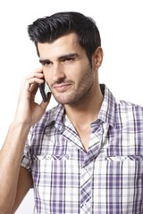 Portrait of young man on mobilephone