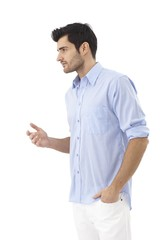 Young man turning right gesturing