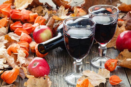Seasoning wine in glass. Red Leaf on table