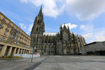 At square near the grand Cologne Cathedral. On the right part of the photo the Roman-German Historical Museum. Cologne, Germany