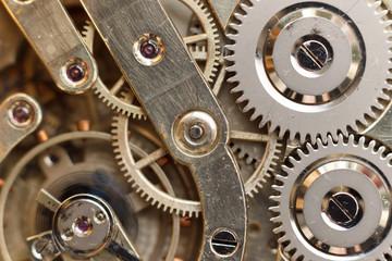Golden Clockwork. Detail of watch machinery. Old mechanical pocket watch. Macro shot.