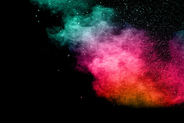 abstract color powder explosion on  black background.abstract  Freeze motion of color powder exploding.