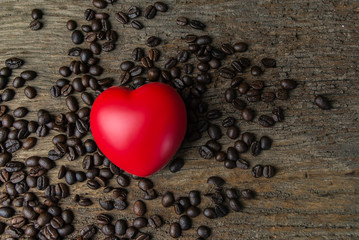 Red heart shape on coffee beans and dark background for valentine's day.