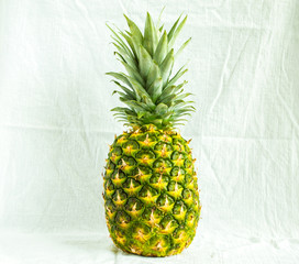 1 whole pineapple on a white cloth