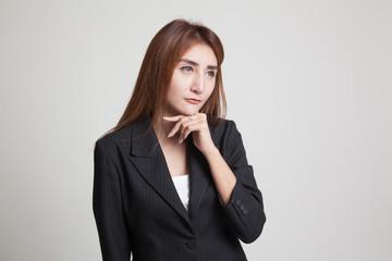 Serious  young Asian woman  look away.