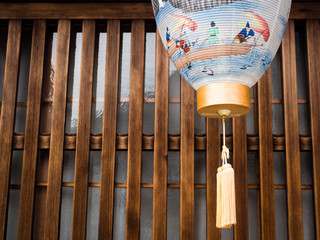 Detail of traditional Japanese house exterior with paper lantern