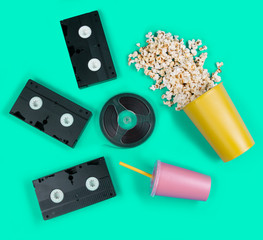 Cinema concept with popcorn on a turquoise background.Minimal art.