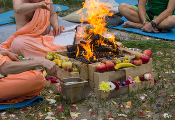 Hindu ritual with cooking and prayer reading