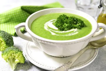 Broccoli soup in a white bowl.