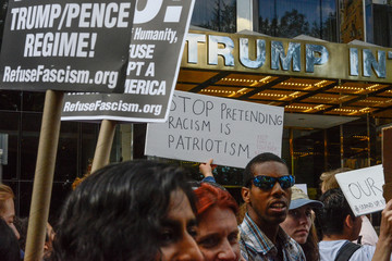 People participate in a protest in defense of the Deferred Action for Childhood Arrivals program or DACA in front of the Trump International Hotel in New York