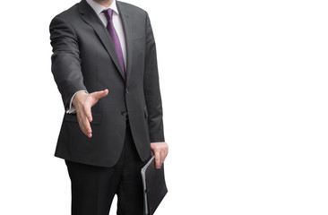 An unknown businessman with open hand ready to seal a deal on white background. Focus on a hand.