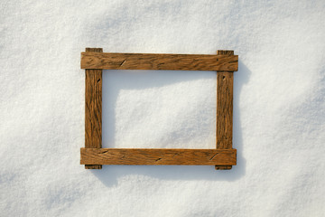 wooden frame on natural snow, copy-space background