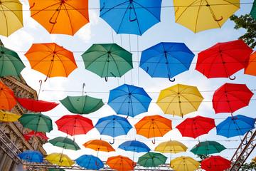 multicolor umbrellas in the sky