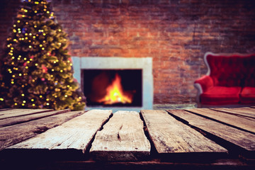 Wall Mural - Christmas and New year background with empty dark wooden deck table over christmas tree and blurred light bokeh. Empty display for product montage. Rustic vintage Xmas background.