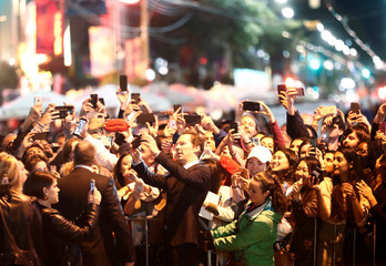"""Cumberbatch poses in front of fans as he arrives on the red carpet for the film """"The Current War"""" during the Toronto International Film Festival in Toronto"""