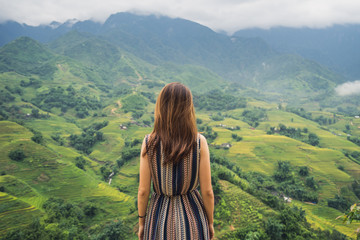 Young traveler standing and looking at view of nature in Sapa, Vitenam