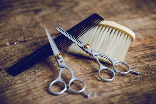 hairdresser tools on wooden table