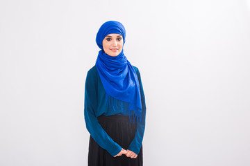 beautiful asian muslim woman model posing on white background in studio