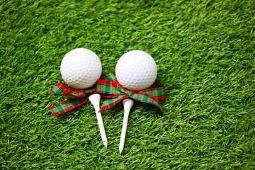 Christmas present for golfer on green grass