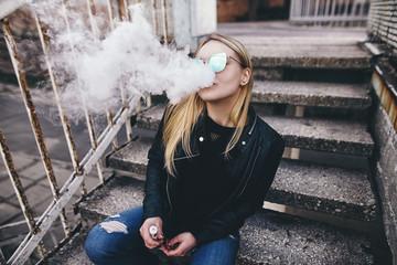 Portrait of sexy young vaping girl. Vapor concept. Vaping e-Cigarette